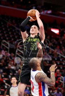 Feb 14, 2018; Detroit, MI, USA; Atlanta Hawks forward Mike Muscala (31) takes a shot over Detroit Pistons guard Jameer Nelson (41) during the fourth quarter at Little Caesars Arena. Mandatory Credit: Raj Mehta-USA TODAY Sports