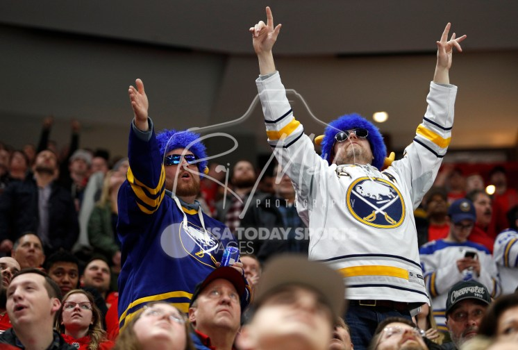 Feb 22, 2018; Detroit, MI, USA; Buffalo Sabres fans celebrate after the game winning goal by defenseman Marco Scandella (not pictured) against the Detroit Red Wings at Little Caesars Arena. Mandatory Credit: Raj Mehta-USA TODAY Sports