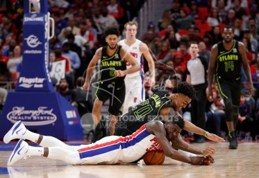 Feb 14, 2018; Detroit, MI, USA; Detroit Pistons forward James Ennis III (33) and Atlanta Hawks forward John Collins (20) dive for the ball during the fourth quarter at Little Caesars Arena. Mandatory Credit: Raj Mehta-USA TODAY Sports