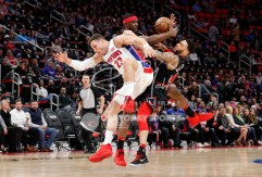 Mar 24, 2018; Detroit, MI, USA; Detroit Pistons forward Blake Griffin (23) Chicago Bulls forward Noah Vonleh (30) and forward Denzel Valentine (45) collide in air going after the ball during the first quarter at Little Caesars Arena. Mandatory Credit: Raj Mehta-USA TODAY Sports