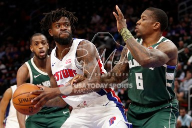 Feb 28, 2018; Detroit, MI, USA; Detroit Pistons forward Reggie Bullock (25) gets defended by Milwaukee Bucks guard Eric Bledsoe (6) during the first quarter at Little Caesars Arena. Mandatory Credit: Raj Mehta-USA TODAY Sports