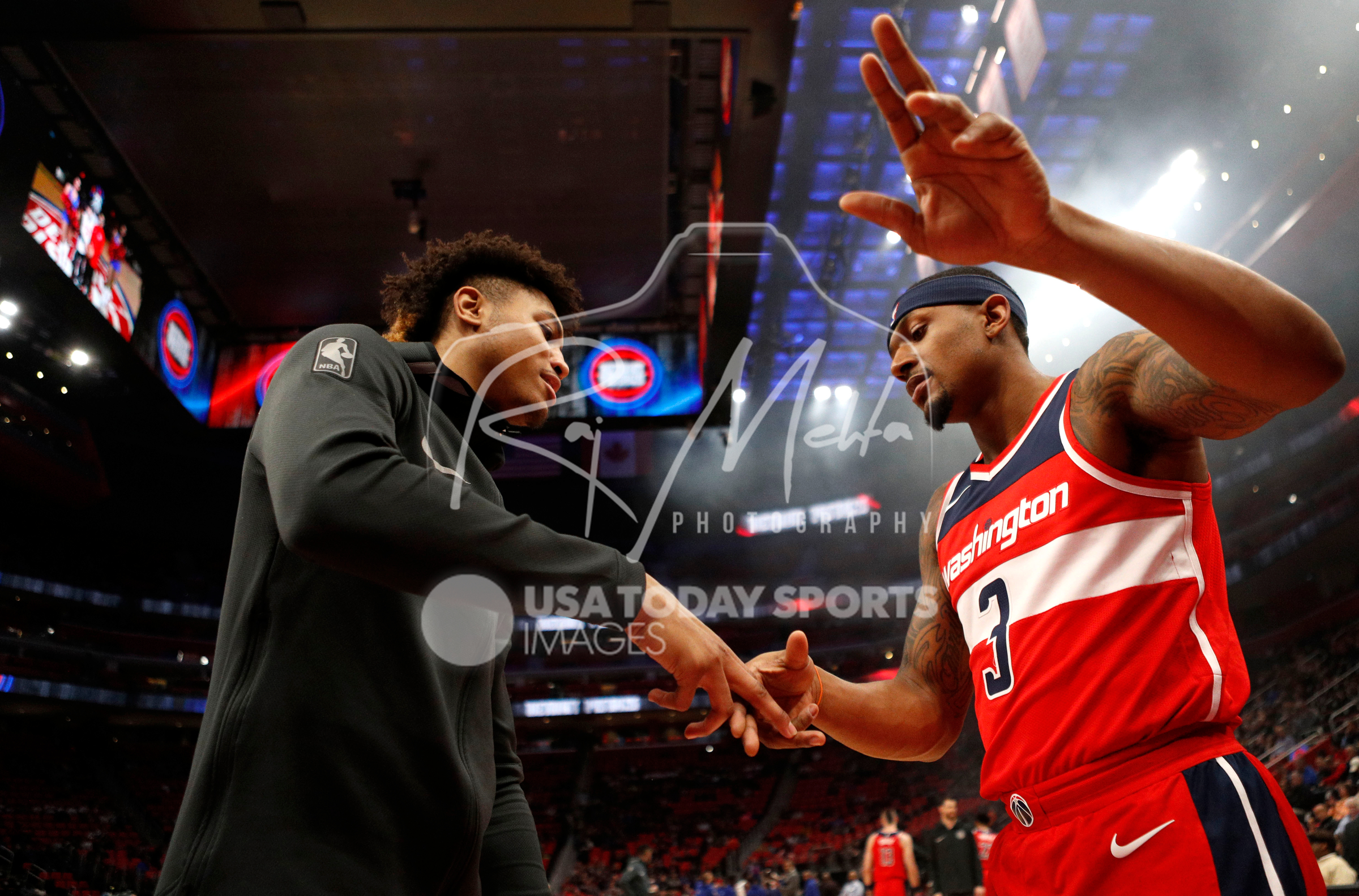 Mar 29, 2018; Detroit, MI, USA; Washington Wizards guard Bradley Beal (3) shakes hands with forward Kelly Oubre Jr. (12) before the game against the Detroit Pistons at Little Caesars Arena. Mandatory Credit: Raj Mehta-USA TODAY Sports