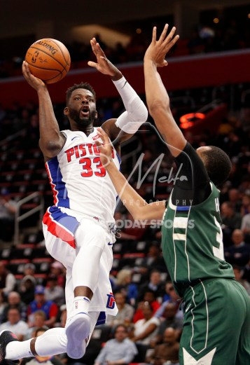 Feb 28, 2018; Detroit, MI, USA; Detroit Pistons forward James Ennis III (33) goes up for a shot against Milwaukee Bucks forward John Henson (31) during the first quarter at Little Caesars Arena. Mandatory Credit: Raj Mehta-USA TODAY Sports