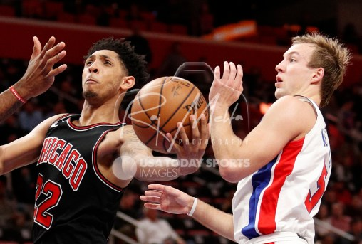 Mar 24, 2018; Detroit, MI, USA; Chicago Bulls guard Cameron Payne (22) goes up for a shot against Detroit Pistons guard Luke Kennard (5) during the third quarter at Little Caesars Arena. Mandatory Credit: Raj Mehta-USA TODAY Sports