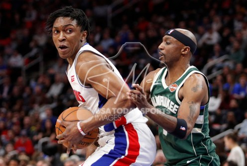 Feb 28, 2018; Detroit, MI, USA; Detroit Pistons forward Stanley Johnson (7) gets defended by Milwaukee Bucks guard Jason Terry (3) during the second quarter at Little Caesars Arena. Mandatory Credit: Raj Mehta-USA TODAY Sports