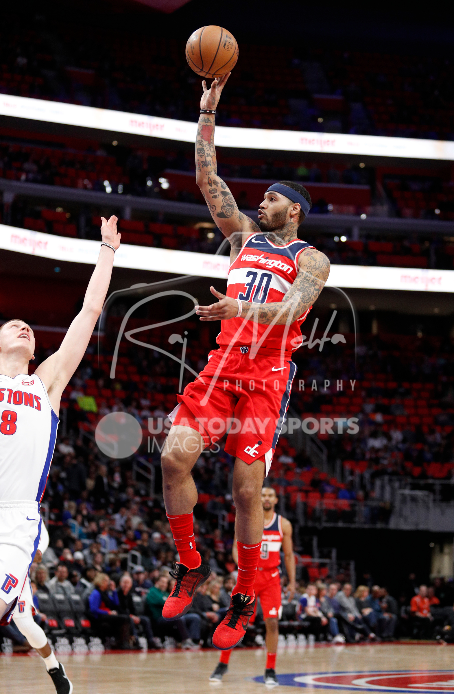 Mar 29, 2018; Detroit, MI, USA; Washington Wizards forward Mike Scott (30) takes a shot over Detroit Pistons forward Henry Ellenson (8) during the second quarter at Little Caesars Arena. Mandatory Credit: Raj Mehta-USA TODAY Sports