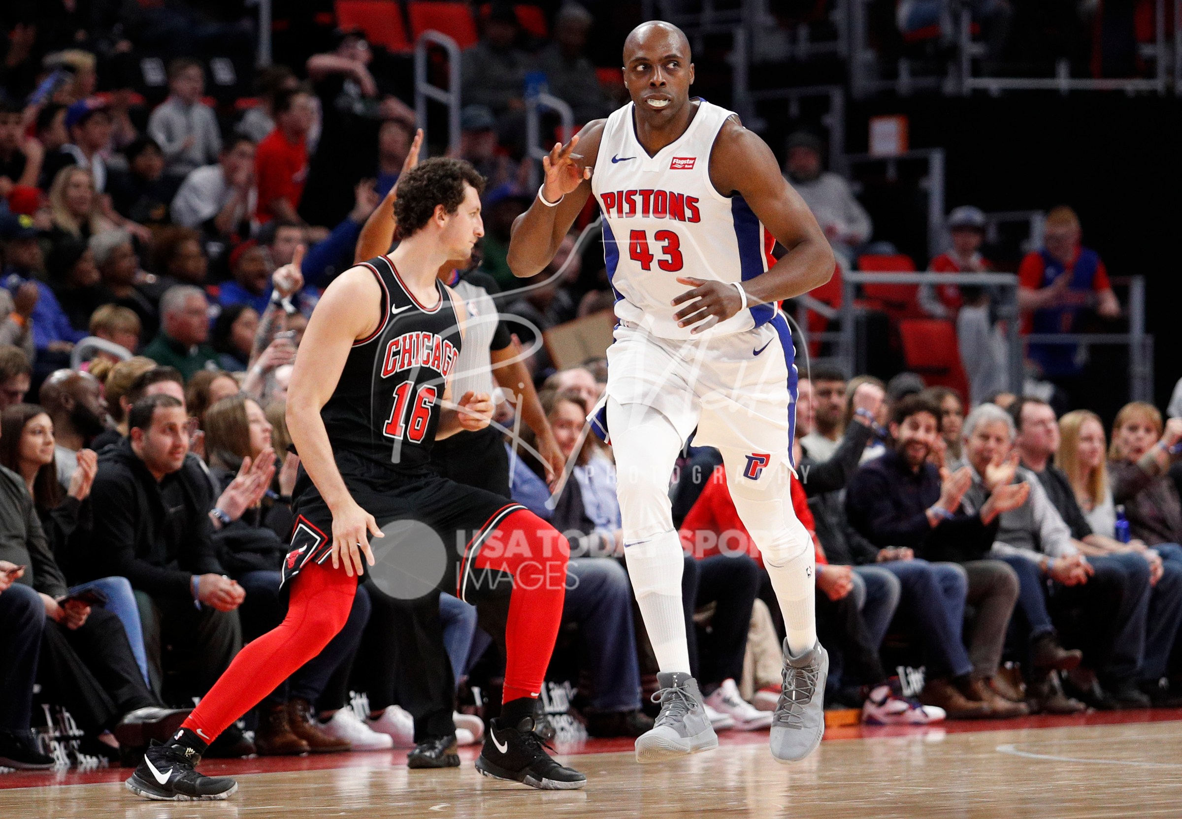 Mar 24, 2018; Detroit, MI, USA; Detroit Pistons forward Anthony Tolliver (43) signals three after making a basket during the third quarter against Chicago Bulls forward Paul Zipser (16) at Little Caesars Arena. Mandatory Credit: Raj Mehta-USA TODAY Sports