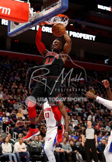 Mar 24, 2018; Detroit, MI, USA; Chicago Bulls forward David Nwaba (11) dunks the ball during the fourth quarter against the Detroit Pistons at Little Caesars Arena. Mandatory Credit: Raj Mehta-USA TODAY Sports