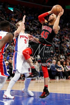Mar 24, 2018; Detroit, MI, USA; Chicago Bulls forward Denzel Valentine (45) takes a shot over Detroit Pistons guard Luke Kennard (5) during the fourth quarter at Little Caesars Arena. Mandatory Credit: Raj Mehta-USA TODAY Sports