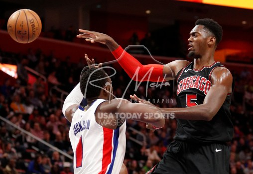 Mar 24, 2018; Detroit, MI, USA; Chicago Bulls forward Bobby Portis (5) passes the ball against Detroit Pistons guard Reggie Jackson (1) during the fourth quarter at Little Caesars Arena. Mandatory Credit: Raj Mehta-USA TODAY Sports