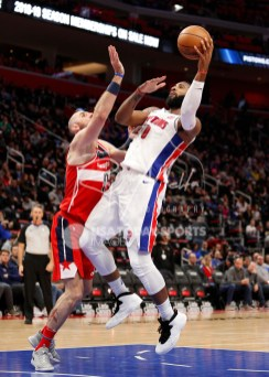 Mar 29, 2018; Detroit, MI, USA; Detroit Pistons center Andre Drummond (0) goes up for a shot against Washington Wizards center Marcin Gortat (13) during the third quarter at Little Caesars Arena. Mandatory Credit: Raj Mehta-USA TODAY Sports