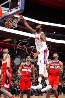 Mar 29, 2018; Detroit, MI, USA; Detroit Pistons center Andre Drummond (0) dunks the ball against Washington Wizards center Marcin Gortat (13) guard Ramon Sessions (9) and forward Mike Scott (30) during the third quarter at Little Caesars Arena. Mandatory Credit: Raj Mehta-USA TODAY Sports