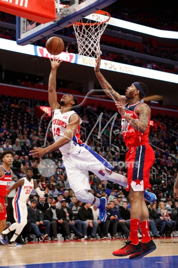 Mar 29, 2018; Detroit, MI, USA; Detroit Pistons guard Ish Smith (14) goes up for a shot against Washington Wizards forward Mike Scott (30) during the fourth quarter at Little Caesars Arena. Mandatory Credit: Raj Mehta-USA TODAY Sports