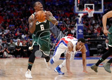 Feb 28, 2018; Detroit, MI, USA; Milwaukee Bucks guard Eric Bledsoe (6) takes a shot after getting fouled by Detroit Pistons guard Ish Smith (14) during the third quarter at Little Caesars Arena. Mandatory Credit: Raj Mehta-USA TODAY Sports