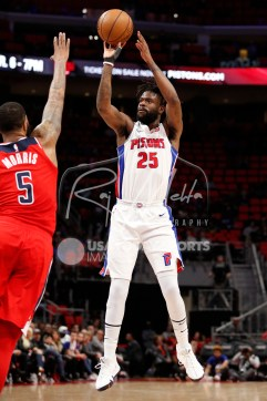 Mar 29, 2018; Detroit, MI, USA; Detroit Pistons guard Reggie Bullock (25) takes a shot over Washington Wizards forward Markieff Morris (5) during the fourth quarter at Little Caesars Arena. Mandatory Credit: Raj Mehta-USA TODAY Sports