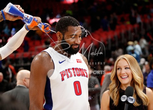 Mar 29, 2018; Detroit, MI, USA; Detroit Pistons center Andre Drummond (0) gets showered with water by forward Eric Moreland (24) after the game just before an interview against the Washington Wizards at Little Caesars Arena. Mandatory Credit: Raj Mehta-USA TODAY Sports