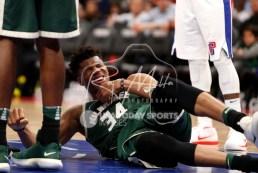 Feb 28, 2018; Detroit, MI, USA; Milwaukee Bucks forward Giannis Antetokounmpo (34) goes down with an injury during the fourth quarter against the Detroit Pistons at Little Caesars Arena. Mandatory Credit: Raj Mehta-USA TODAY Sports