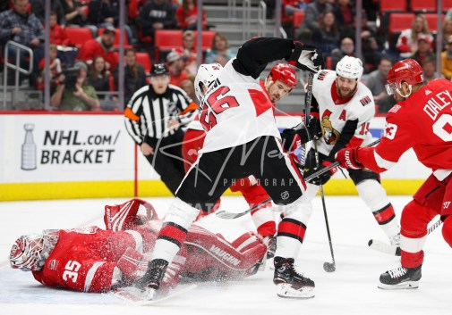 Mar 31, 2018; Detroit, MI, USA; Detroit Red Wings goaltender Jimmy Howard (35) makes a save against Ottawa Senators left wing Magnus Paajarvi (56) during the first period at Little Caesars Arena. Mandatory Credit: Raj Mehta-USA TODAY Sports