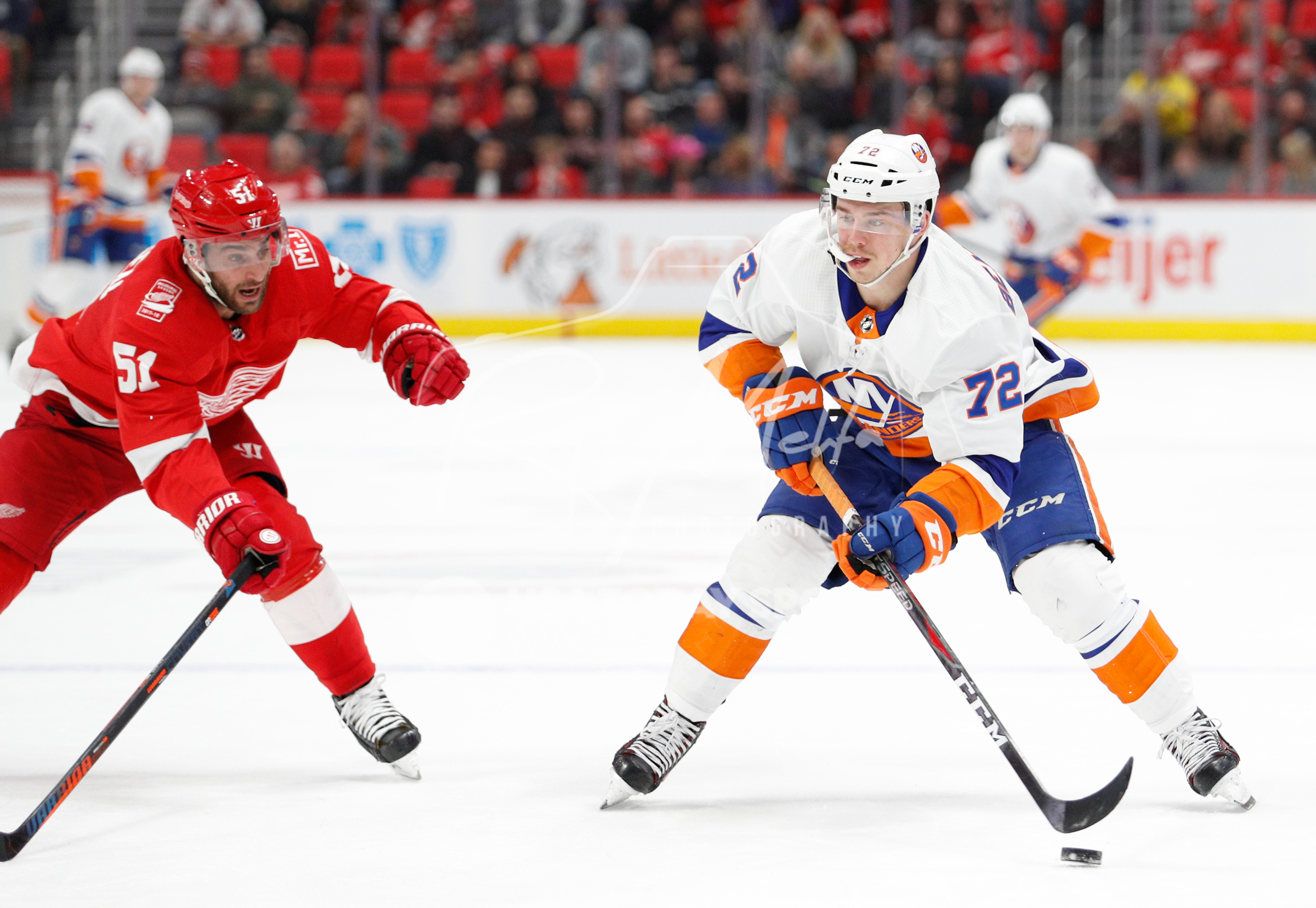 Apr 7, 2018; Detroit, MI, USA; New York Islanders center Anthony Beauvillier (72) skates with the puck against Detroit Red Wings center Frans Nielsen (51) during the first period at Little Caesars Arena. Mandatory Credit: Raj Mehta-USA TODAY Sports