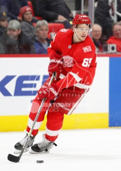 Apr 5, 2018; Detroit, MI, USA; Detroit Red Wings defenseman Danny DeKeyser (65) skates with the puck during the first period against the Montreal Canadiens at Little Caesars Arena. Mandatory Credit: Raj Mehta-USA TODAY Sports