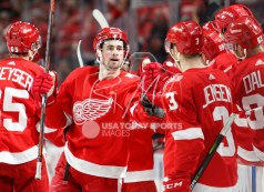 Apr 5, 2018; Detroit, MI, USA; Detroit Red Wings center Dylan Larkin (71) celebrates with teammates after scoring a goal during the first period against the Montreal Canadiens at Little Caesars Arena. Mandatory Credit: Raj Mehta-USA TODAY Sports