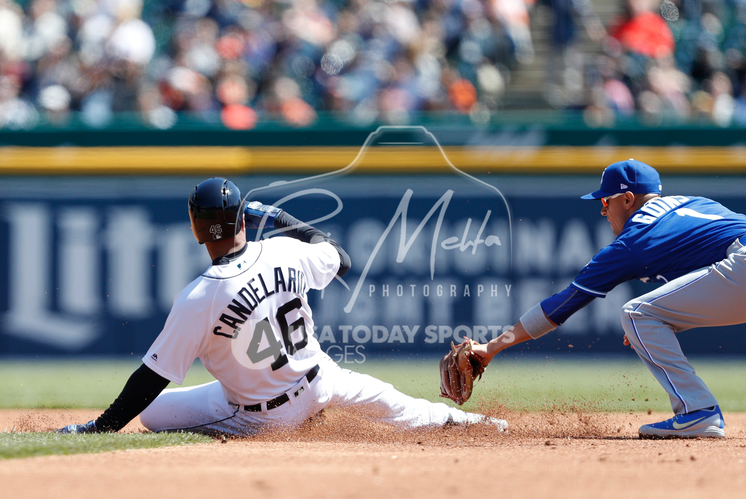 Apr 22, 2018; Detroit, MI, USA; Detroit Tigers third baseman Jeimer Candelario (46) slides safe into second base as Kansas City Royals second baseman Ryan Goins (1) misses the tag during the first inning at Comerica Park. Mandatory Credit: Raj Mehta-USA TODAY Sports