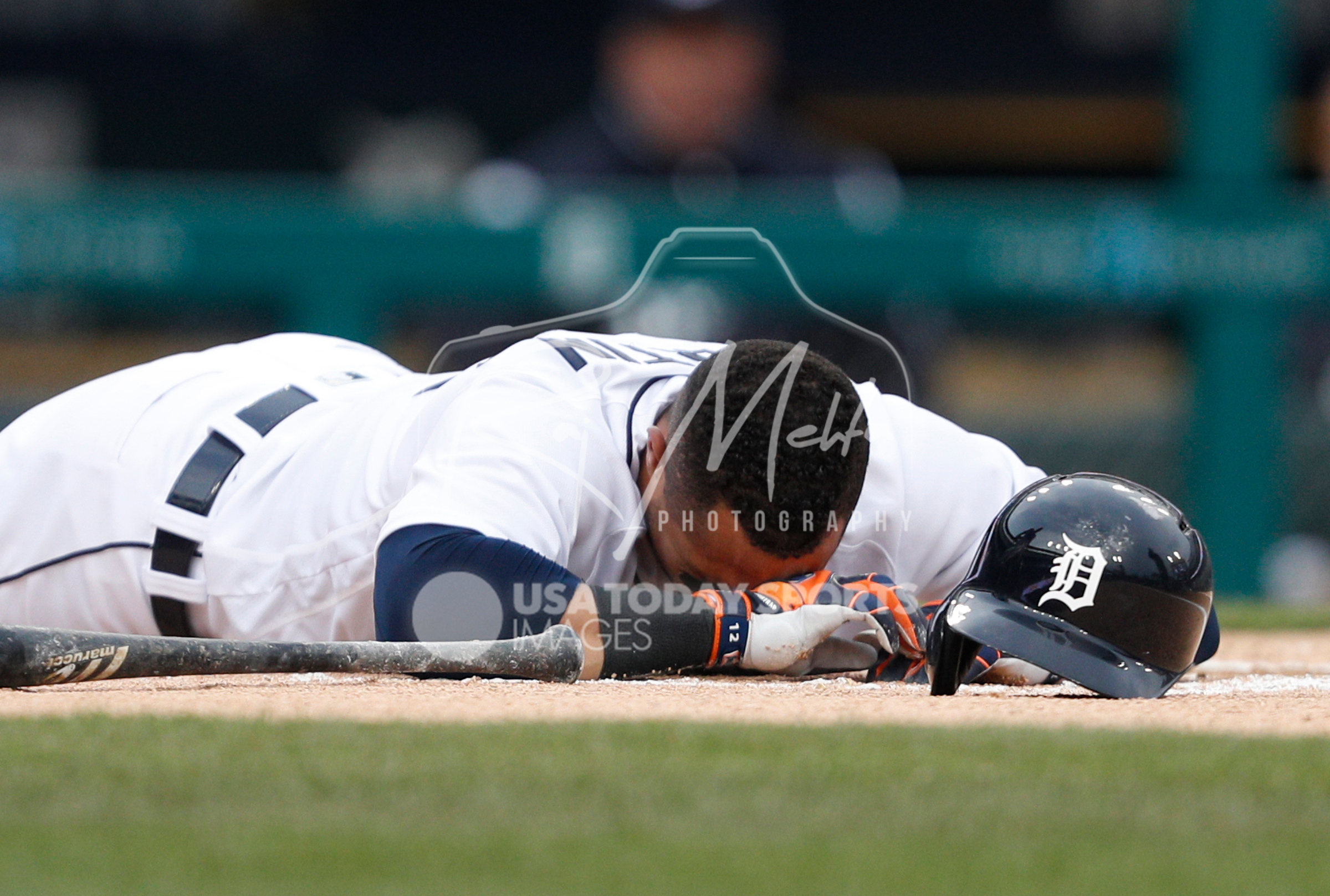 Apr 13, 2018; Detroit, MI, USA; Detroit Tigers center fielder Leonys Martin (12) goes down after an injury during the first inning against the New York Yankees at Comerica Park. Mandatory Credit: Raj Mehta-USA TODAY Sports