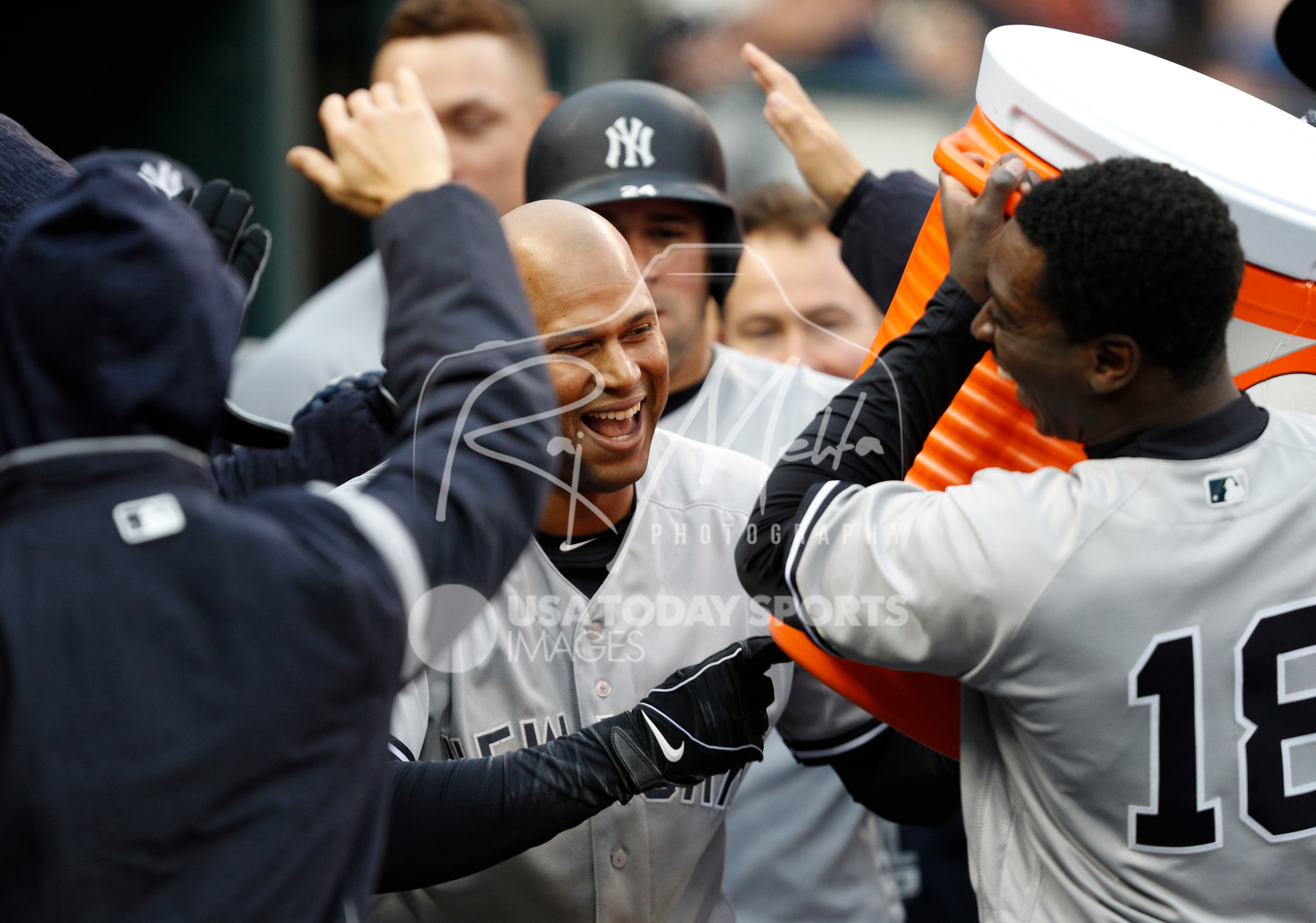Apr 13, 2018; Detroit, MI, USA; New York Yankees center fielder Aaron Hicks (31) celebrates with teammates after hitting an inside the park home run that scores two during the second inning against the Detroit Tigers at Comerica Park. Mandatory Credit: Raj Mehta-USA TODAY Sports