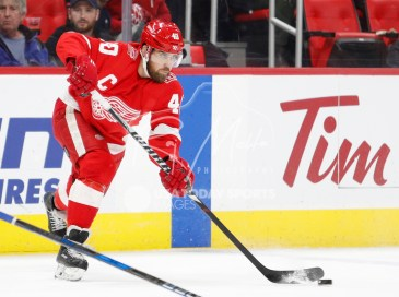 Apr 5, 2018; Detroit, MI, USA; Detroit Red Wings center Henrik Zetterberg (40) passes the puck during the second period against the Montreal Canadiens at Little Caesars Arena. Mandatory Credit: Raj Mehta-USA TODAY Sports