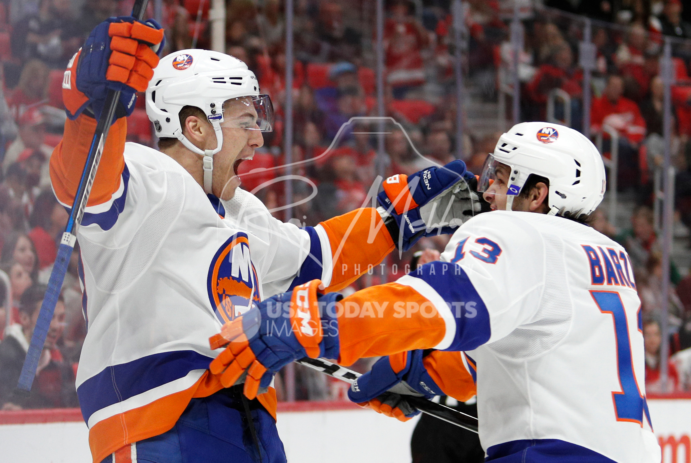 Apr 7, 2018; Detroit, MI, USA; New York Islanders left wing Anders Lee (27) celebrates with center Mathew Barzal (13) after scoring a goal during the third period against the Detroit Red Wings at Little Caesars Arena. Mandatory Credit: Raj Mehta-USA TODAY Sports