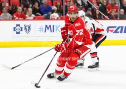 Mar 31, 2018; Detroit, MI, USA; Detroit Red Wings left wing Andreas Athanasiou (72) skates away from Ottawa Senators right wing Alexandre Burrows (14) during the third period at Little Caesars Arena. Mandatory Credit: Raj Mehta-USA TODAY Sports