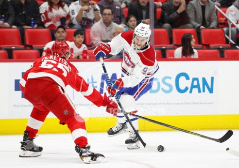 Apr 5, 2018; Detroit, MI, USA; Montreal Canadiens center Jonathan Drouin (92) gets defended by Detroit Red Wings defenseman Danny DeKeyser (65) during the third period at Little Caesars Arena. Mandatory Credit: Raj Mehta-USA TODAY Sports