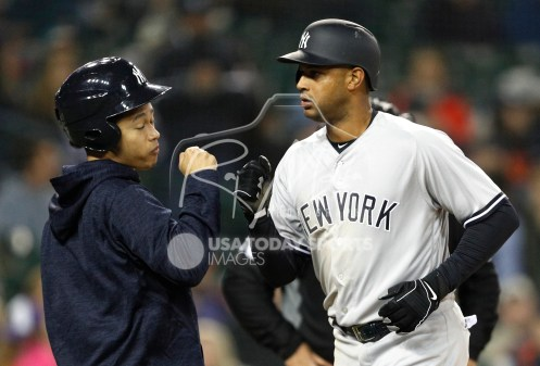 Apr 13, 2018; Detroit, MI, USA; New York Yankees center fielder Aaron Hicks (31) fist bumps a batboy after rounding the bases for a solo home run during the sixth inning against the Detroit Tigers at Comerica Park. Mandatory Credit: Raj Mehta-USA TODAY Sports