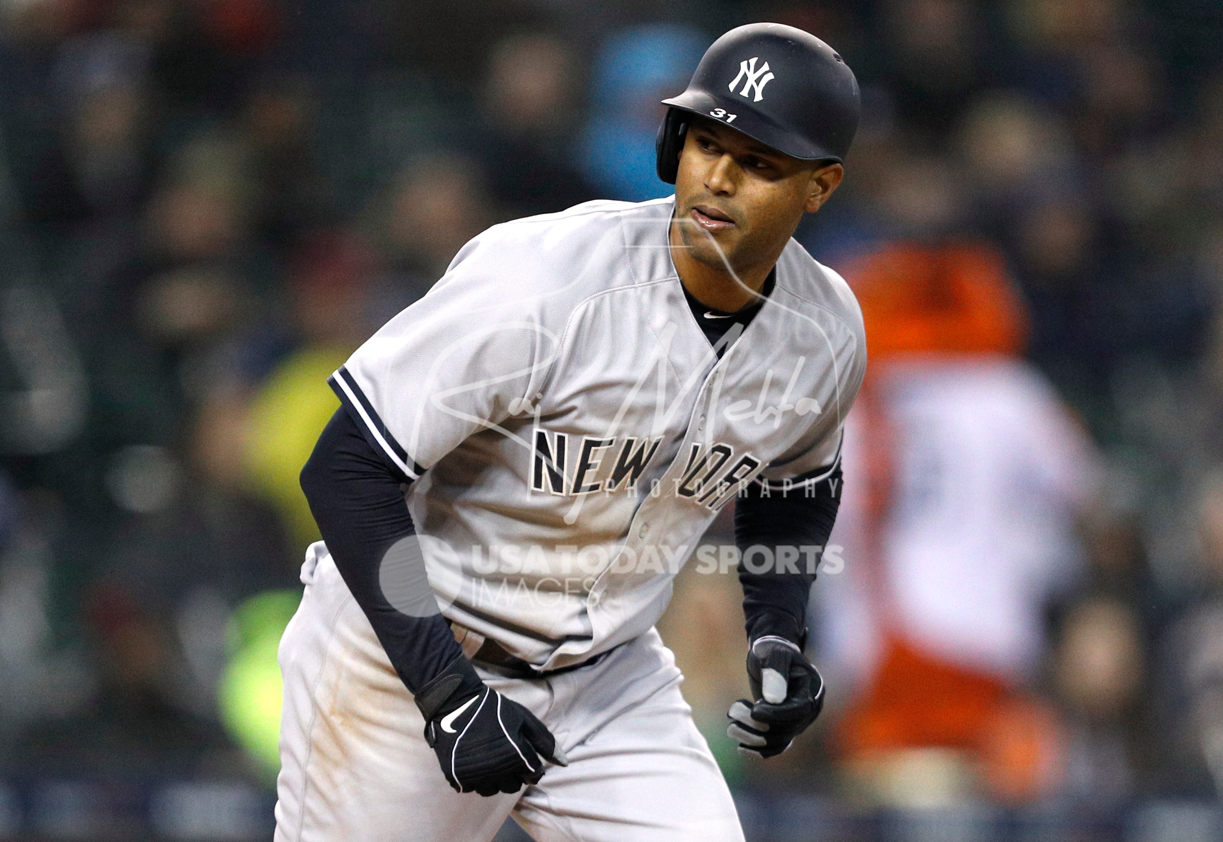 Apr 13, 2018; Detroit, MI, USA; New York Yankees center fielder Aaron Hicks (31) trots to first base with a walk during the seventh inning against the Detroit Tigers at Comerica Park. Mandatory Credit: Raj Mehta-USA TODAY Sports