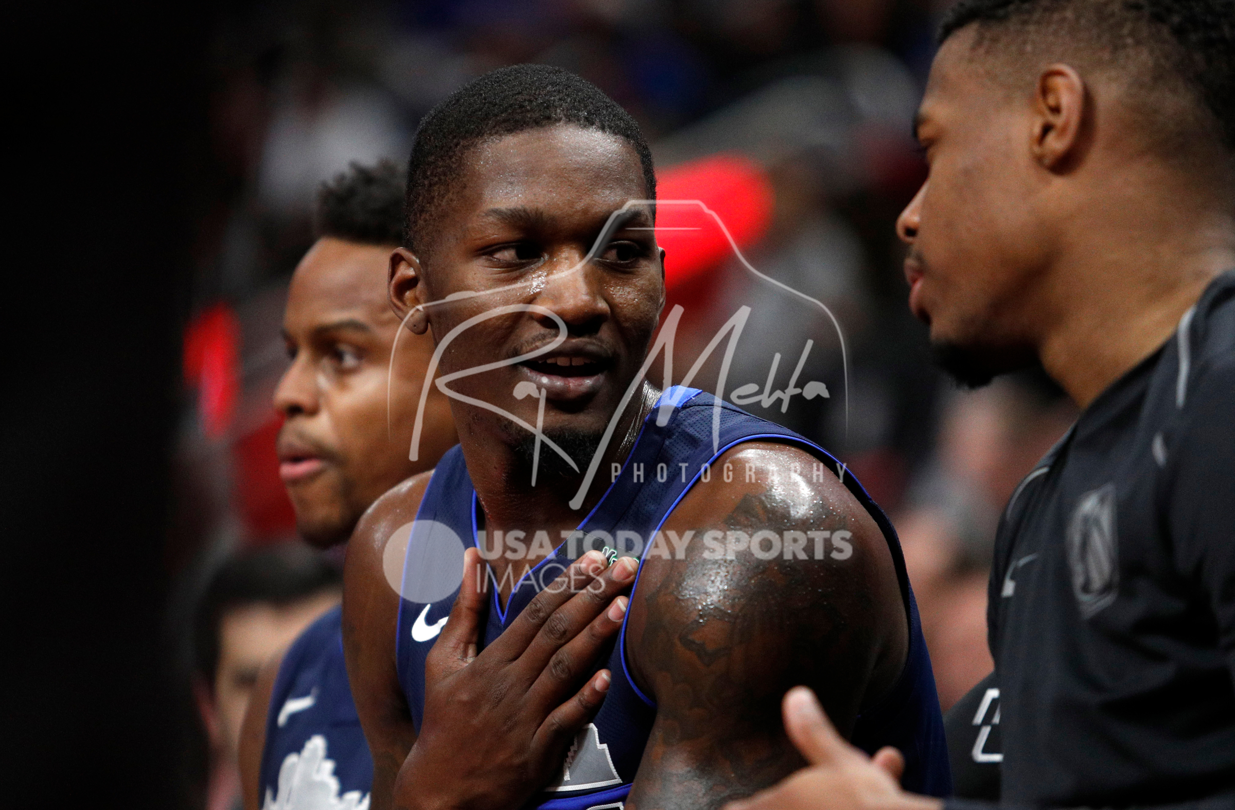 Apr 6, 2018; Detroit, MI, USA; Dallas Mavericks forward Dorian Finney-Smith (10) talks on the bench during the second quarter against the Detroit Pistons at Little Caesars Arena. Mandatory Credit: Raj Mehta-USA TODAY Sports