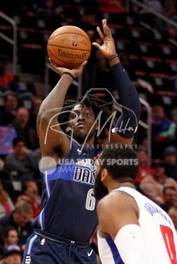 Apr 6, 2018; Detroit, MI, USA; Dallas Mavericks forward Johnathan Motley (6) takes a shot over Detroit Pistons center Andre Drummond (0) during the second quarter at Little Caesars Arena. Mandatory Credit: Raj Mehta-USA TODAY Sports