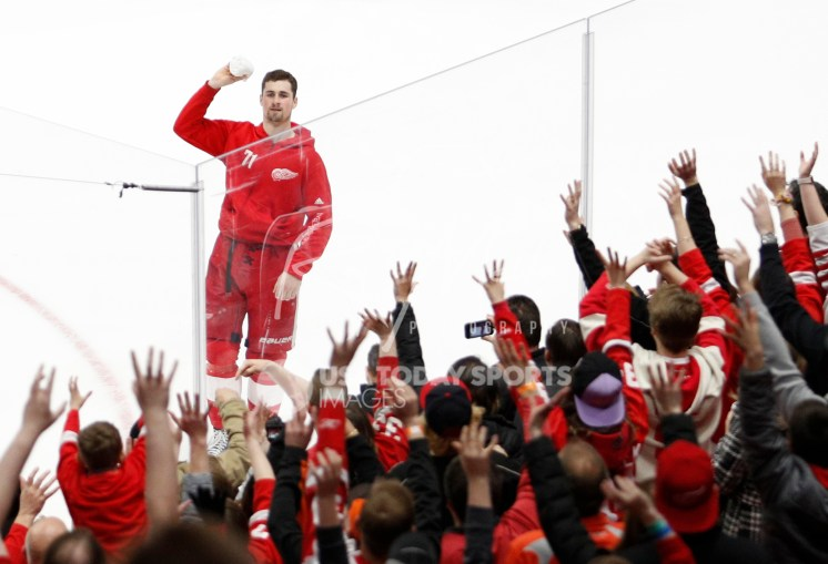 Apr 7, 2018; Detroit, MI, USA; Detroit Red Wings center Dylan Larkin (71) throws a shirt into the crowd after the game against the New York Islanders at Little Caesars Arena. Mandatory Credit: Raj Mehta-USA TODAY Sports
