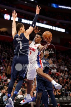 Apr 6, 2018; Detroit, MI, USA; Detroit Pistons forward Stanley Johnson (7) goes up for a shot against Dallas Mavericks center Dwight Powell (7) and forward Johnathan Motley (6) during the third quarter at Little Caesars Arena. Mandatory Credit: Raj Mehta-USA TODAY Sports