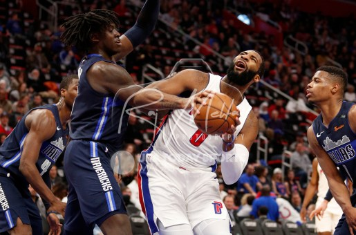 Apr 6, 2018; Detroit, MI, USA; Detroit Pistons center Andre Drummond (0) gets fouled by Dallas Mavericks forward Johnathan Motley (6) during the third quarter at Little Caesars Arena. Mandatory Credit: Raj Mehta-USA TODAY Sports
