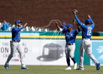 Apr 22, 2018; Detroit, MI, USA; (Left to right) Kansas City Royals right fielder Paulo Orlando (16) right fielder Abraham Almonte (45) and right fielder Jorge Soler (12) celebrate after the game against the Detroit Tigers at Comerica Park. Mandatory Credit: Raj Mehta-USA TODAY Sports