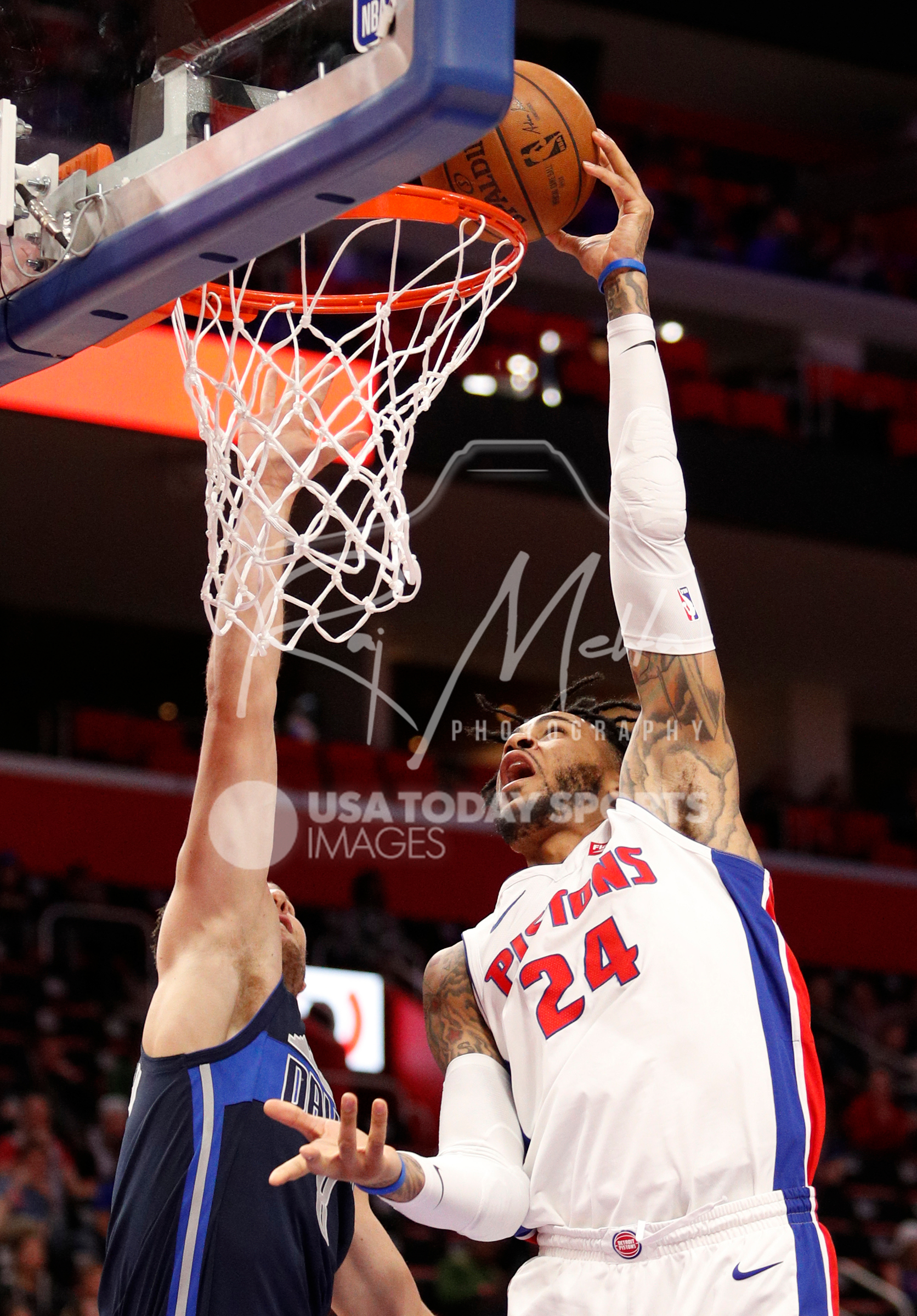 Apr 6, 2018; Detroit, MI, USA; Detroit Pistons forward Eric Moreland (24) attempts a dunk against Dallas Mavericks guard Kyle Collinsworth (8) during the fourth quarter at Little Caesars Arena. Mandatory Credit: Raj Mehta-USA TODAY Sports