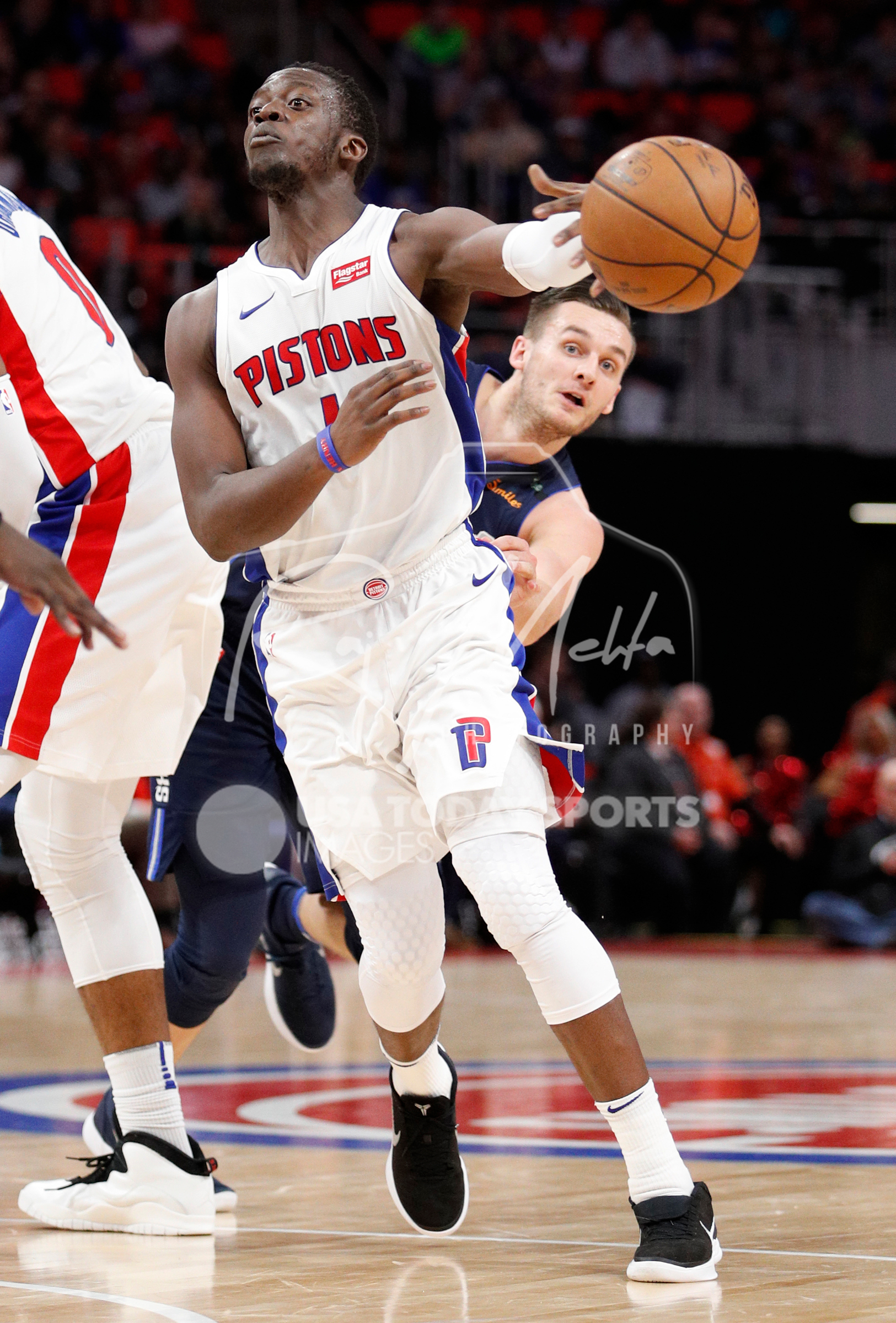 Apr 6, 2018; Detroit, MI, USA; Detroit Pistons guard Reggie Jackson (1) passes the ball in front of Dallas Mavericks guard Kyle Collinsworth (8) during the fourth quarter at Little Caesars Arena. Mandatory Credit: Raj Mehta-USA TODAY Sports