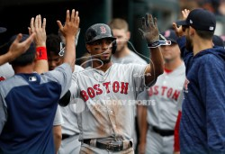 Jul 22, 2018; Detroit, MI, USA; Boston Red Sox shortstop Xander Bogaerts (2) celebrates with teammates in the dugout after scoring during the second inning against the Detroit Tigers at Comerica Park. Mandatory Credit: Raj Mehta-USA TODAY Sports