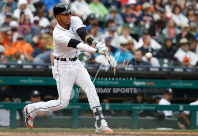 Jul 22, 2018; Detroit, MI, USA; Detroit Tigers right fielder Victor Reyes (22) gets a hit for a single during the third inning against the Boston Red Sox at Comerica Park. Mandatory Credit: Raj Mehta-USA TODAY Sports