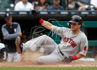 Jul 22, 2018; Detroit, MI, USA; Boston Red Sox left fielder Andrew Benintendi (16) slides safe into home plate during the seventh inning against the Detroit Tigers at Comerica Park. Mandatory Credit: Raj Mehta-USA TODAY Sports