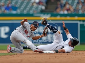 Jul 22, 2018; Detroit, MI, USA; Boston Red Sox shortstop Tzu-Wei Lin (5) tags out Detroit Tigers catcher James McCann (34) at second base during the seventh inning at Comerica Park. Mandatory Credit: Raj Mehta-USA TODAY Sports