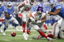 Aug 17, 2018; Detroit, MI, USA; New York Giants wide receiver Hunter Sharp (15) fumbles the ball as he is grabbed by Detroit Lions fullback Nick Bellore (43) during the first quarter at Ford Field. Mandatory Credit: Raj Mehta-USA TODAY Sports