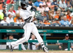 Aug 1, 2018; Detroit, MI, USA; Detroit Tigers shortstop Niko Goodrum (28) gets a hit for a single during the seventh inning against the Cincinnati Reds at Comerica Park. Mandatory Credit: Raj Mehta-USA TODAY Sports