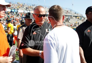 Sep 15, 2018; Toledo, OH, USA; Miami Hurricanes head coach Mark Richt shakes hands with Toledo Rockets head coach Jason Candle after the game at Glass Bowl. Mandatory Credit: Raj Mehta-USA TODAY Sports