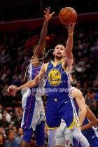 Dec 1, 2018; Detroit, MI, USA; Golden State Warriors guard Stephen Curry (30) goes up for a shot against Detroit Pistons guard Reggie Bullock (25) during the third quarter at Little Caesars Arena. Mandatory Credit: Raj Mehta-USA TODAY Sports